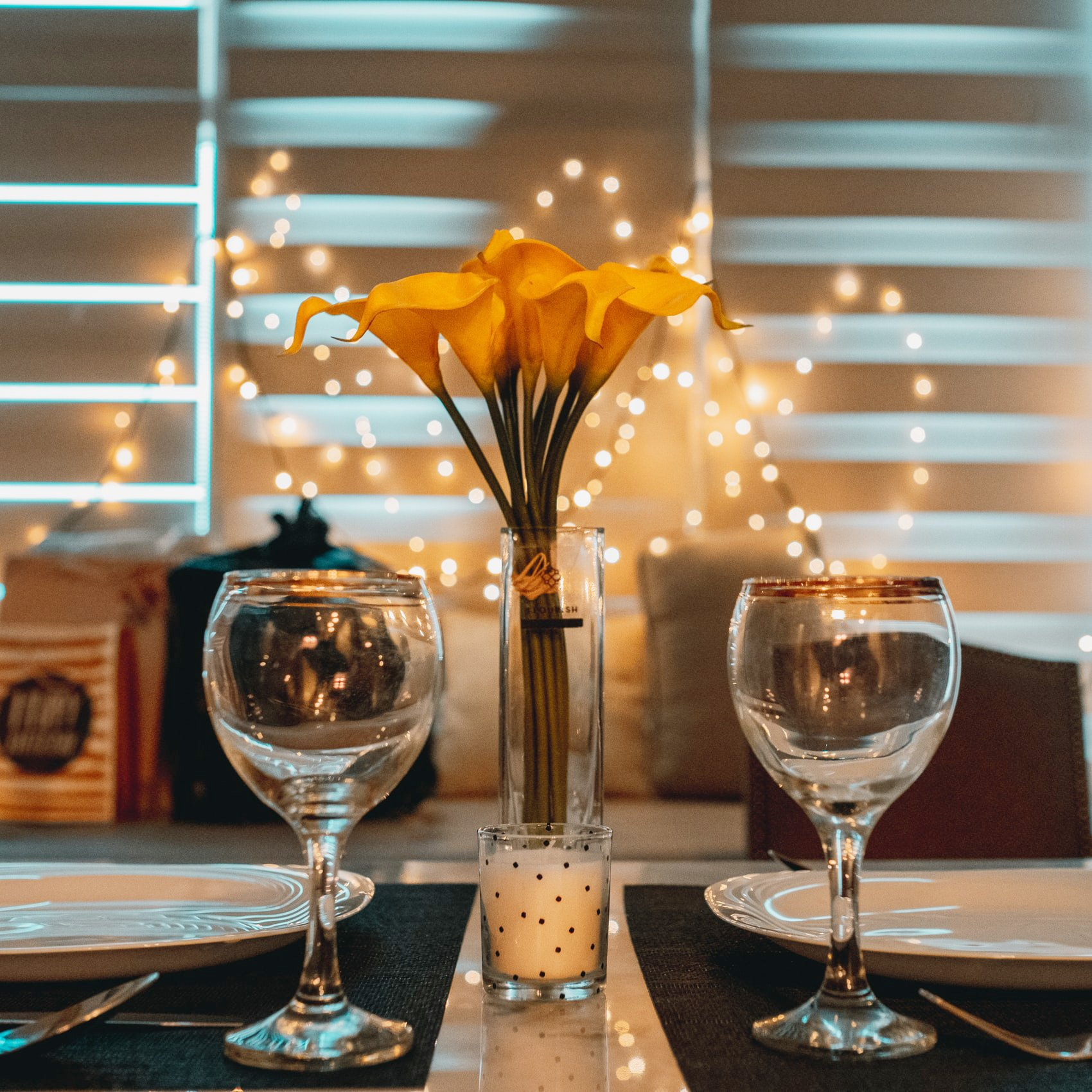 Wine glasses at dinner setting for meal delivery service