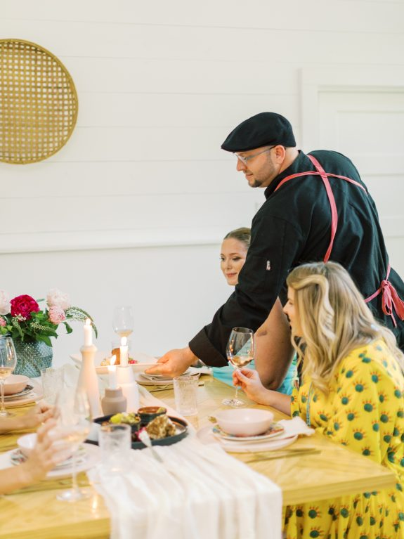 Chef Michael Wards from The Austin Artisan Plating Food at a Girl's Dinner Party