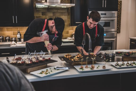 The Austin Artisan team prepares dinner for a private party.
