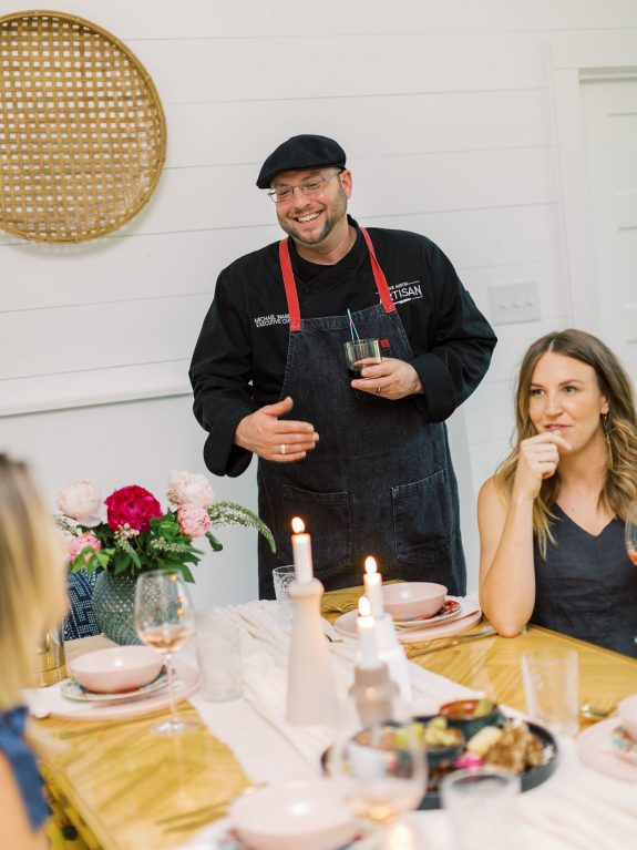The Austin Artisan Chef Michael Wards interacts with guests at a dinner party.