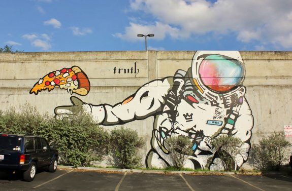 Street art of astronaut and pizza in Austin, TX. (picture credit to wikicommons)