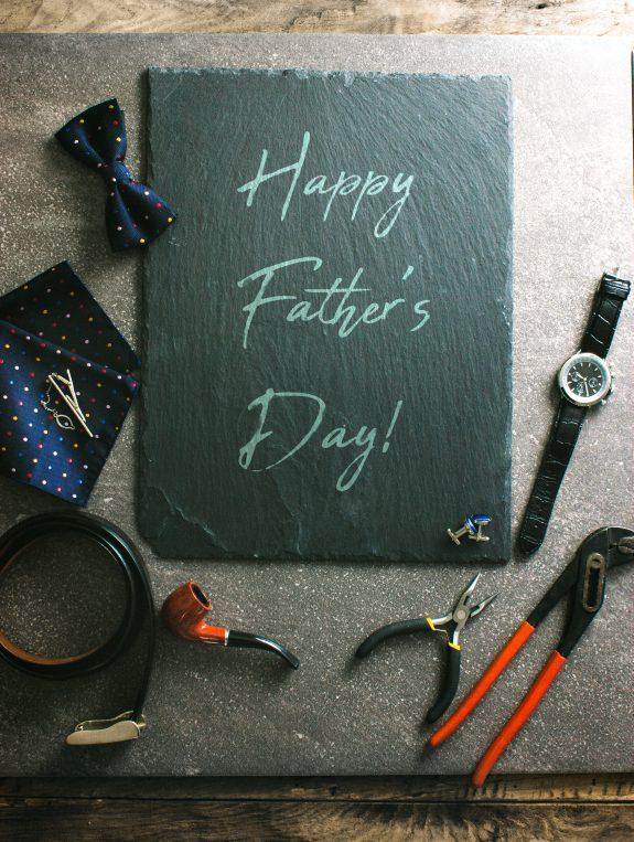 Happy Father's Day written on chalkboard.