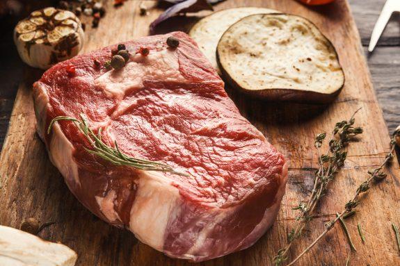 Juicy USDA grade steaks on a cutting board.