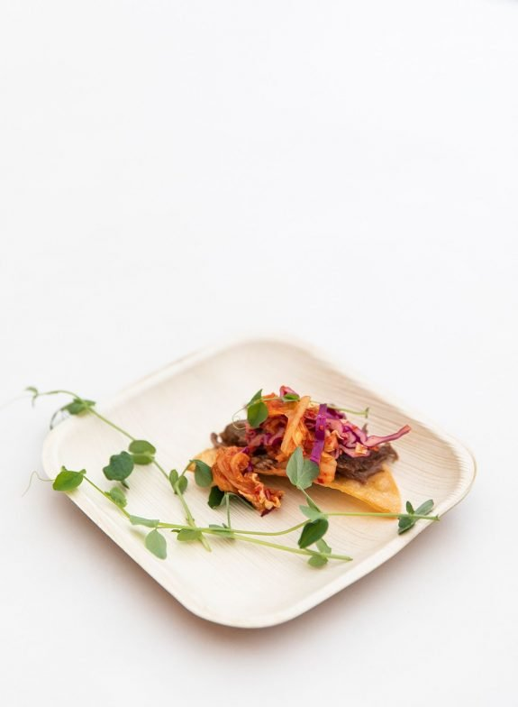 Imaginative snack breaks could include delicious foods like this short rib tostada with kimchi slaw from The Austin Artisan.