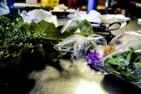 Fresh flowers and greens used to make The Austin Artisan meal delivery services.