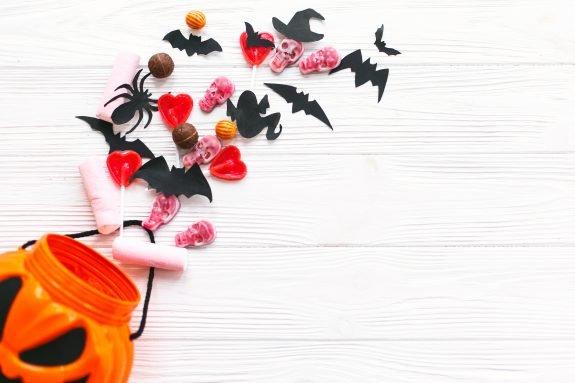 Pumpkin basket spills out treats.